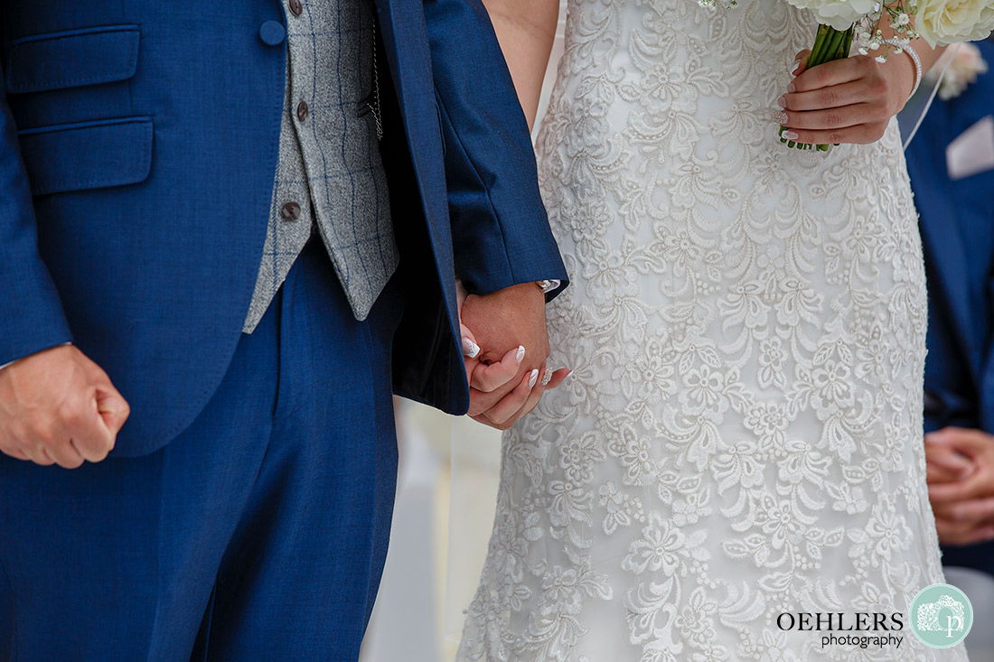 Stoke Rochford Wedding Photographer-Bride and Groom holding hands.