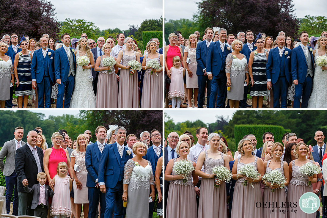 Stoke Rochford Wedding Photographer-Side view of the guests having their group photograph done.
