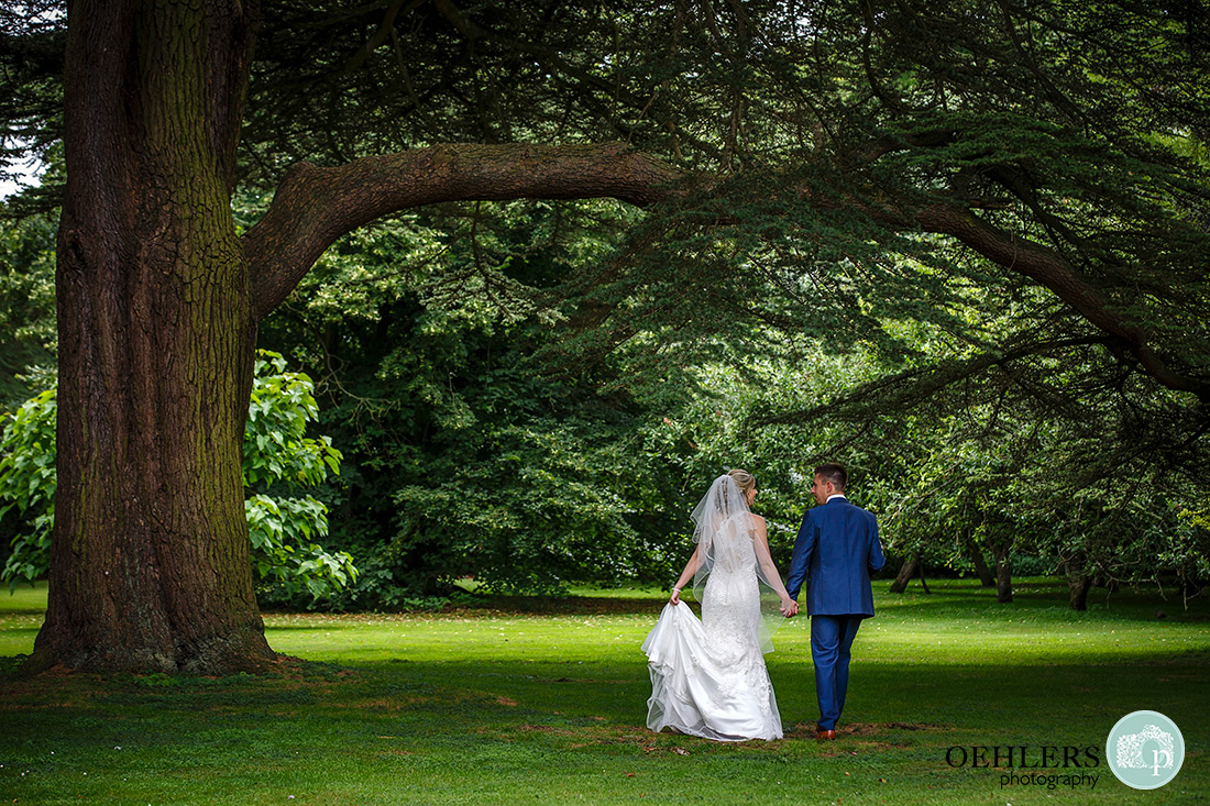 Stoke Rochford Photographer-Bride and Groom walking away from the camera.
