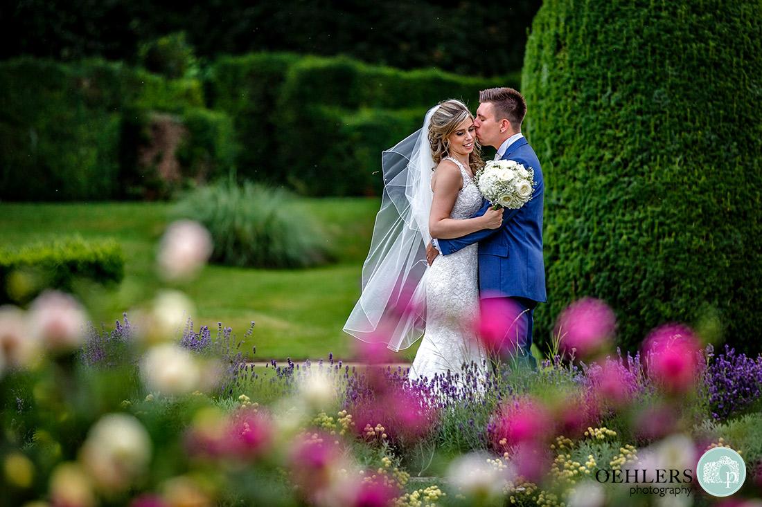 Stoke Rochford Wedding Photographer-Romantic shot of the couple in the garden of the venue.
