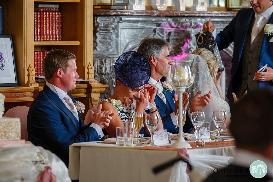 Mum emotional whilst groom makes his speech.