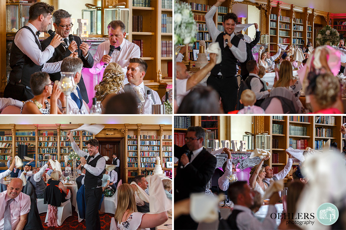 Guests twirling their serviettes around in the air to the songs of the singing waiters.