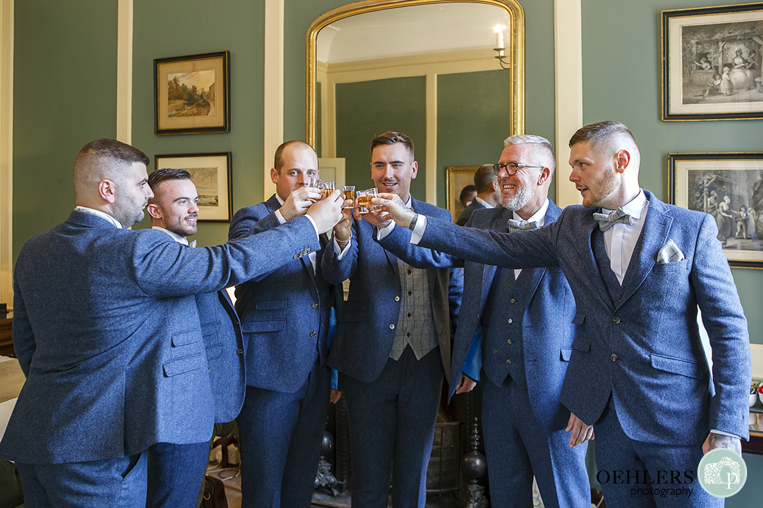 Prestwold Hall wedding photographer - A toast of a shot to the groom with his groomsmen.