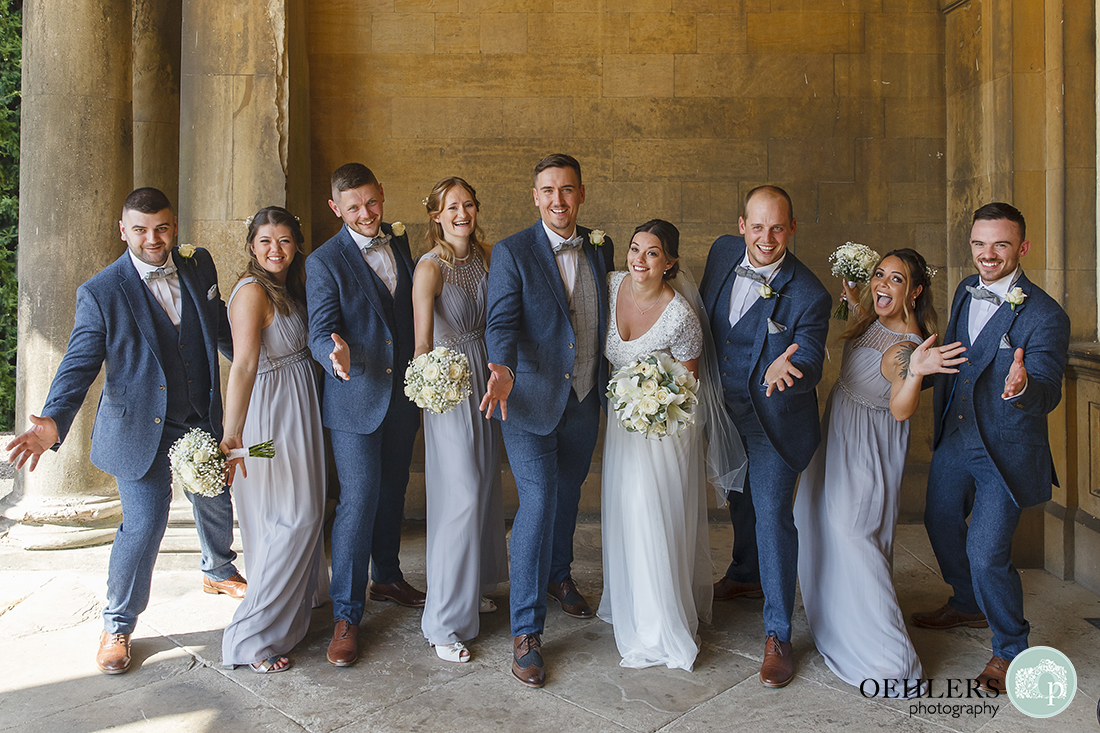 Wedding photographer at Prestwold - Bridal Party showing jazz hands.