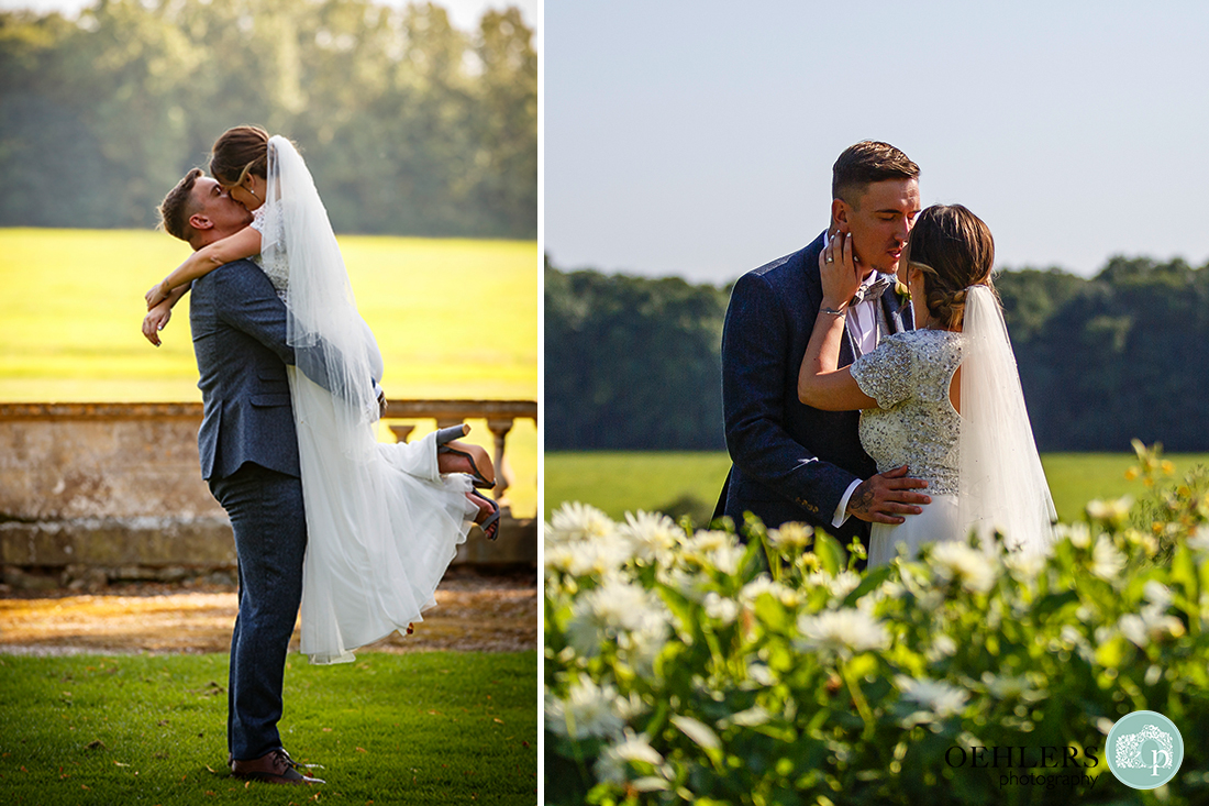 Wedding photographs in the garden - Groom lifting his bride to give her a kiss.