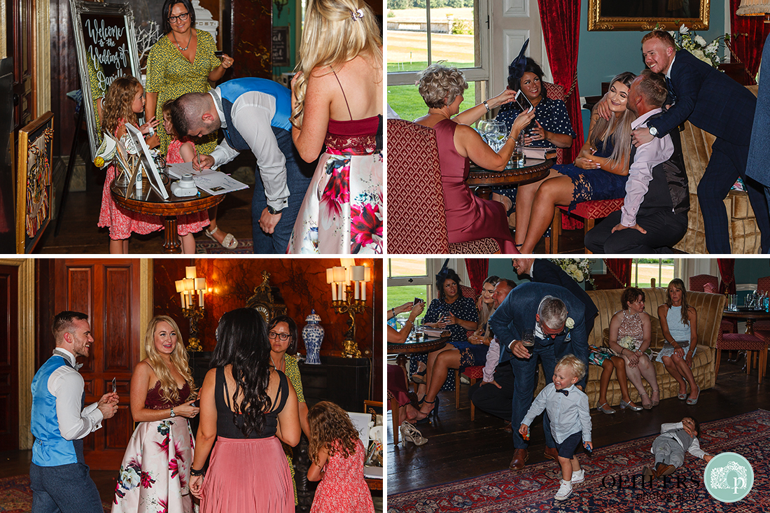 Prestwold Hall Wedding Photographs - Guests indoors mingling and enjoying their day.