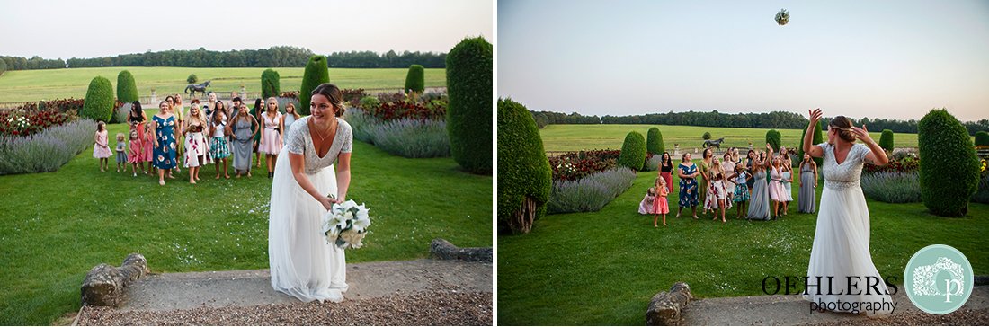 Prestwold Hall Wedding Photographs - The throwing of the wedding bridal bouquet.