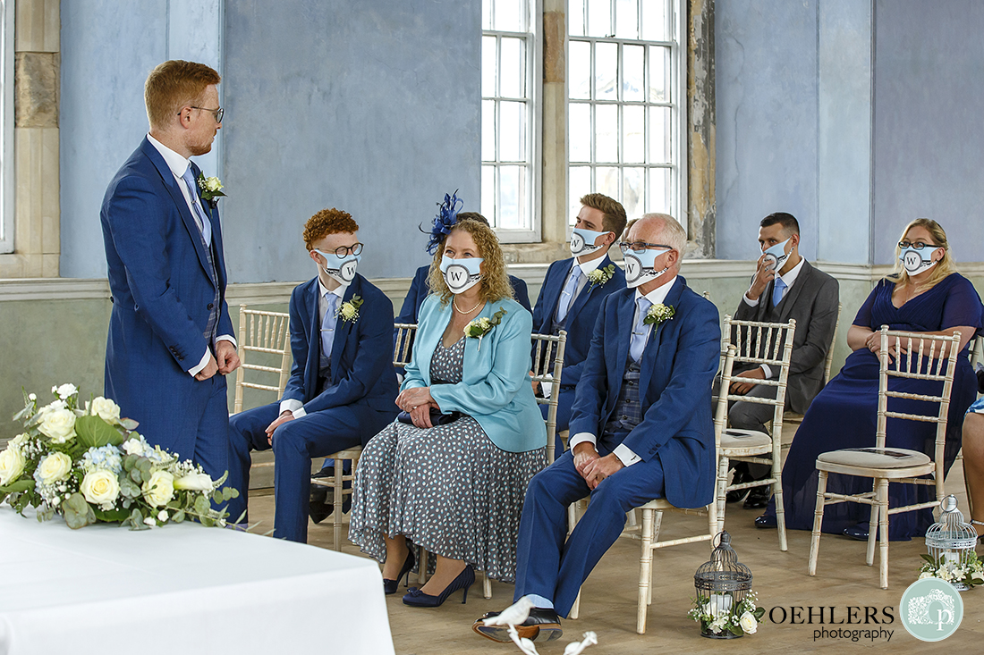 guests wearing masks in the ceremony room