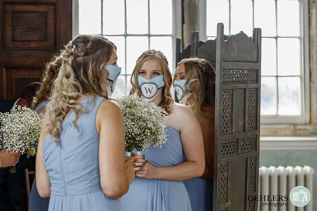 bridesmaids waiting to go down the aisle at wollaston hall