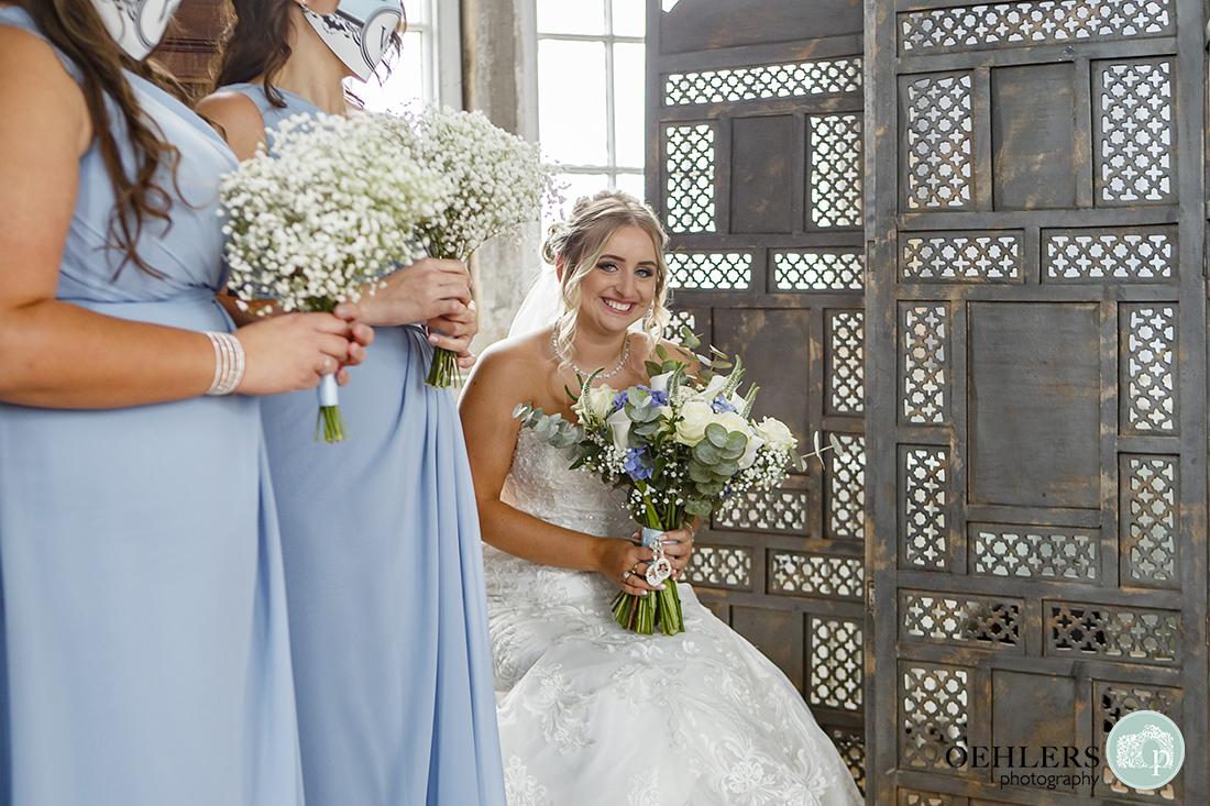 wollaton hall wedding photography of the bride waiting