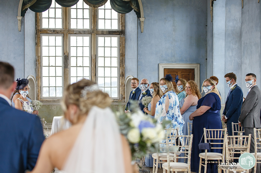 wollaton hall wedding photography of groom looking back at the bride