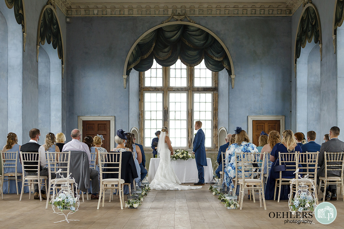 wollaton hall wedding photography of bride and groom saying their vows