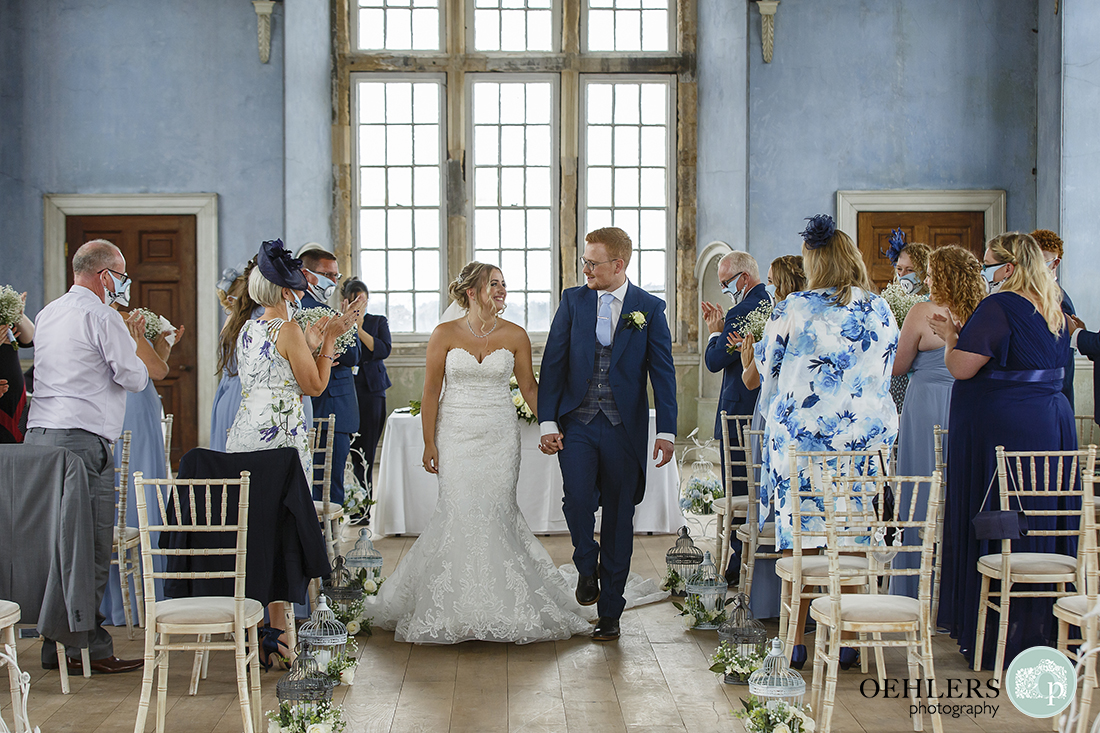 wollaton hall wedding photography of bride and groom walking back up the aisle
