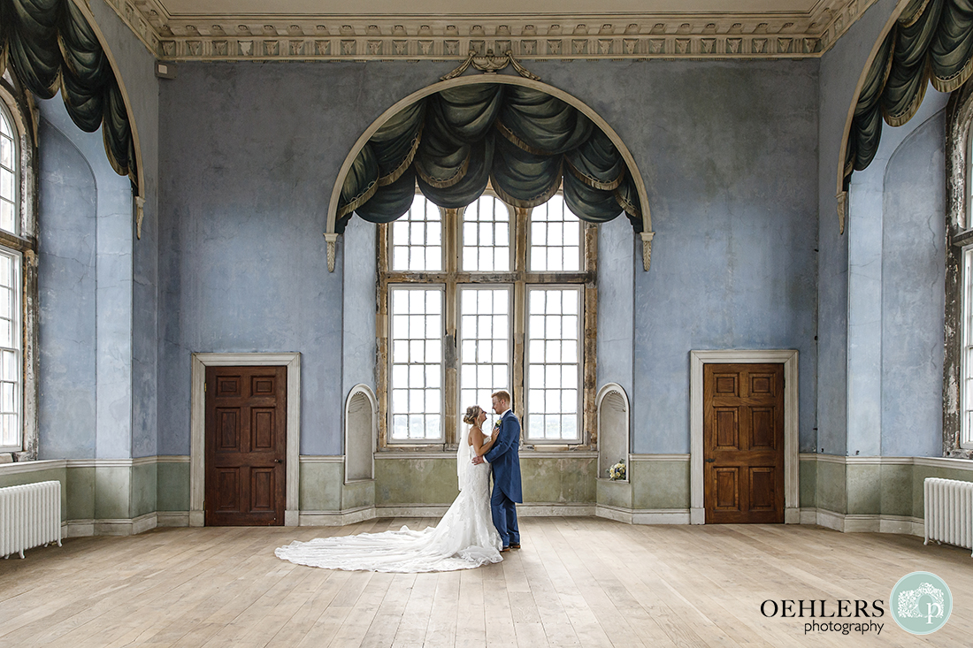 wollaton hall wedding photography of the bride and groom in the prospect room