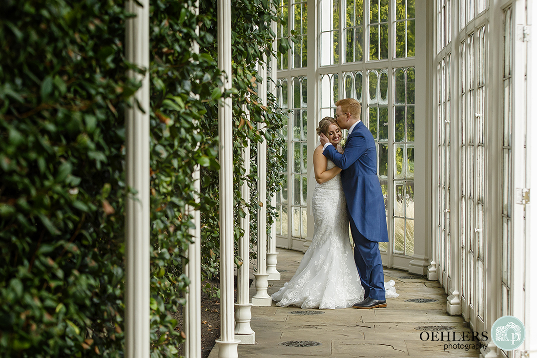 wedding photography of bride and groom inside the Camellia House at Wollaton Hall