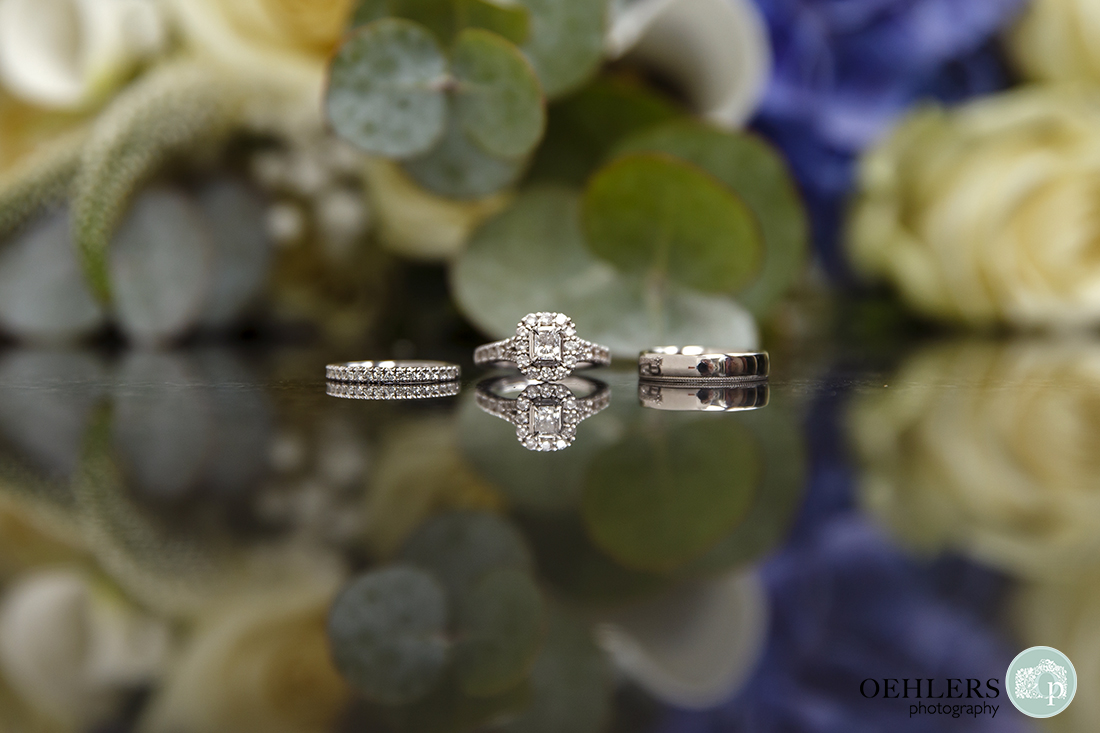 wedding photography of the wedding rings at Wollaton Hall