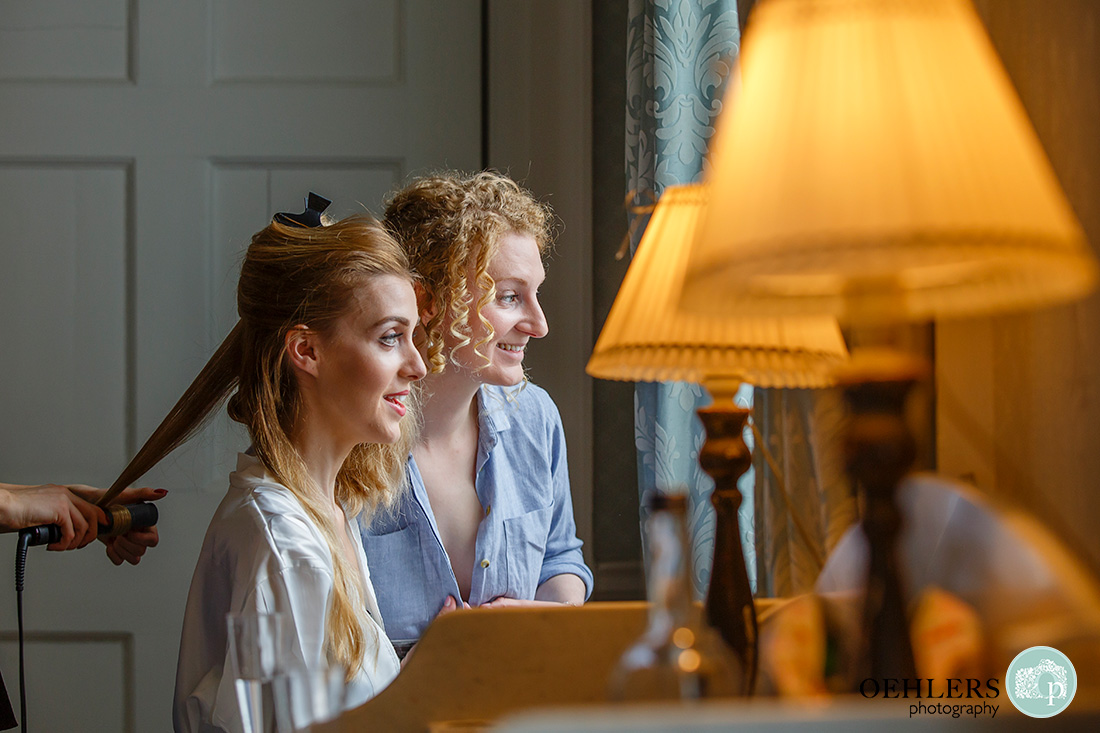 norwood park wedding photography - birde and bridesmaid looking out the window