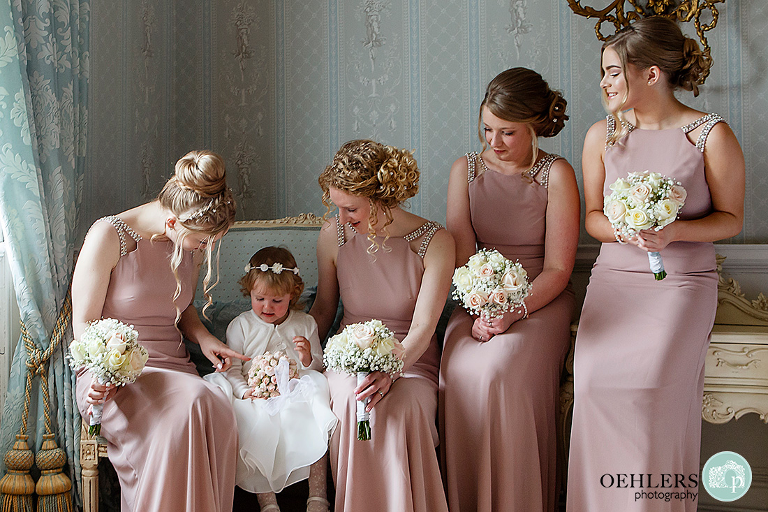 bridal party at Norwood Park - a candid photograph of the bridesmaids and flower girl sitting down