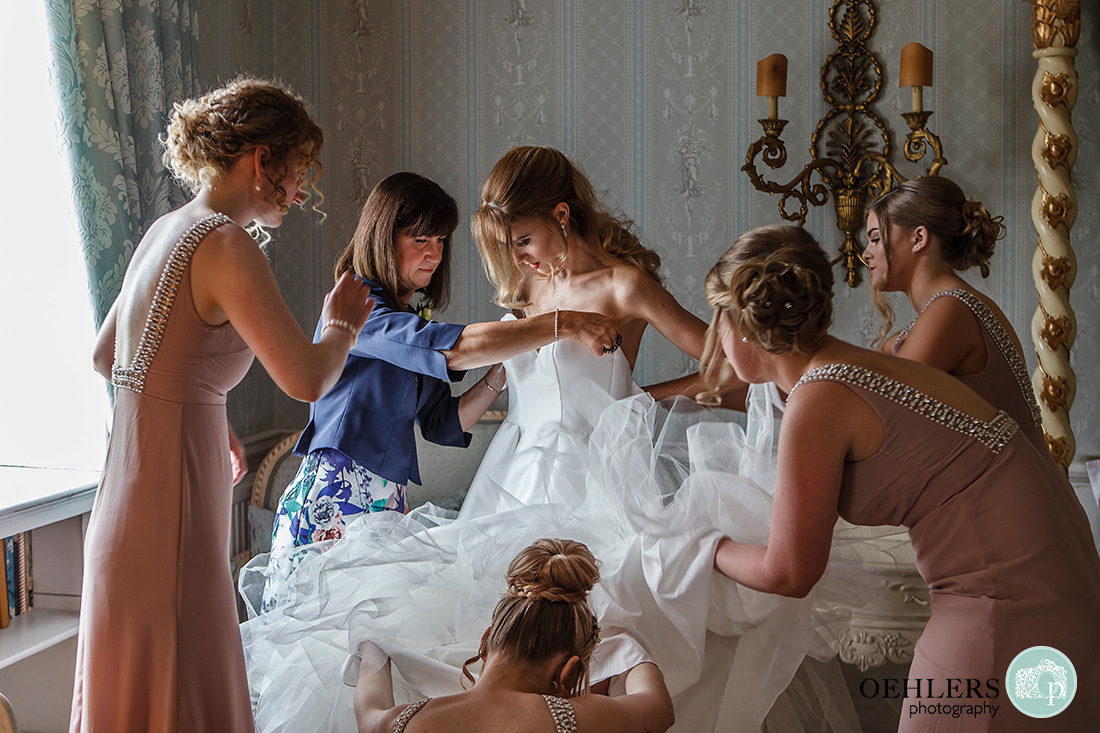 Norwood Park Wedding - bridesmaids and mum getting the bride ready