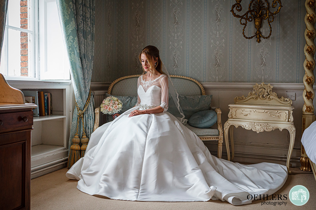 Norwood Park Wedding - bride siting down for a portrait.