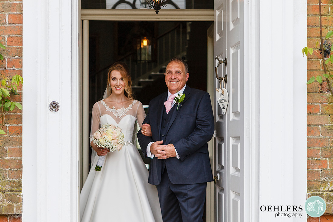 Norwood Park Wedding - bride and dad exiting Norwood Park