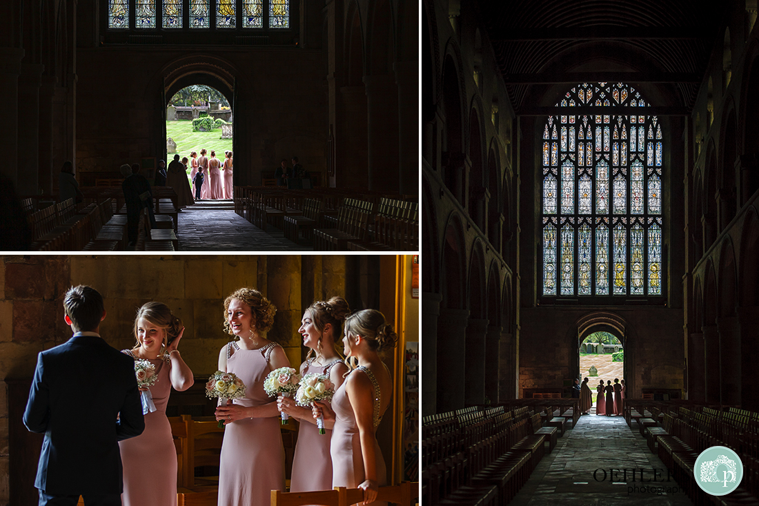Southwell Minster wedding ceremony - photographs of the bridesmaids waiting for their bride just inside the doorway of the Minster