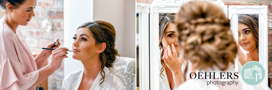Bride have her make up done and looking into the mirror.