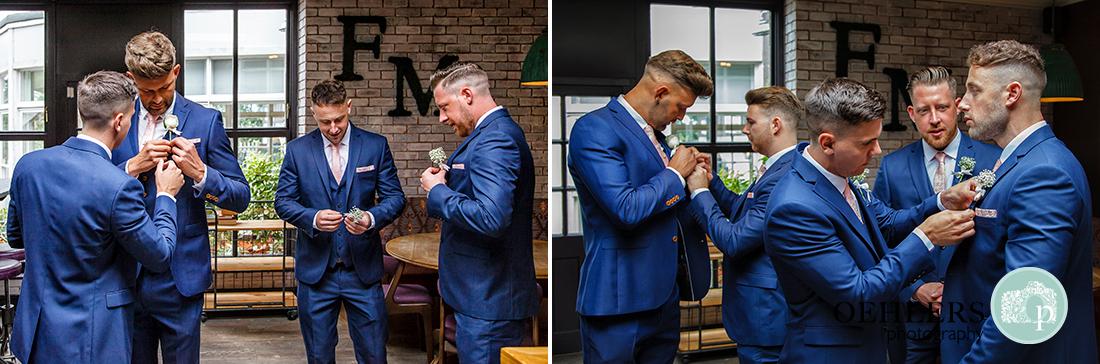Osmaston Park wedding photography - Groomsmen putting on their button holes.