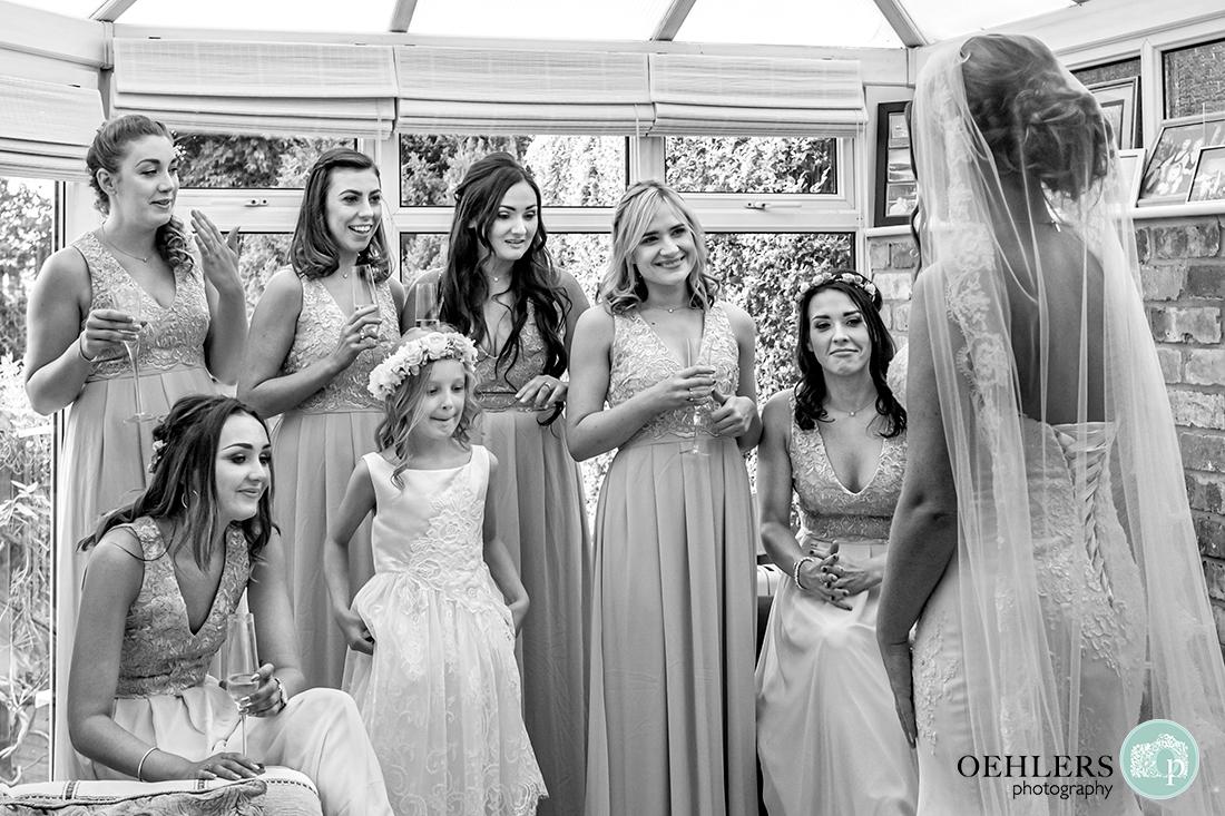 Osmaston Park wedding photography - Bridesmaids seeing their bride in her dress.