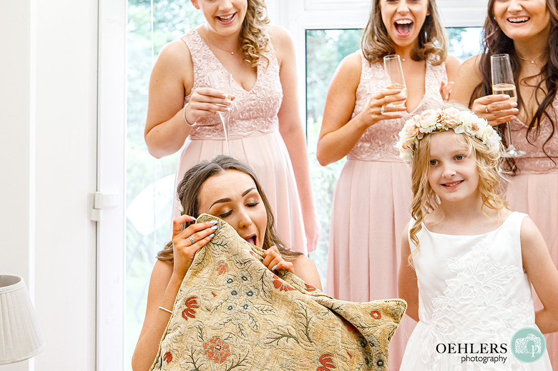 Osmaston Park wedding photography - An emotional bridesmaid using a cushion cover to dampen her tears.