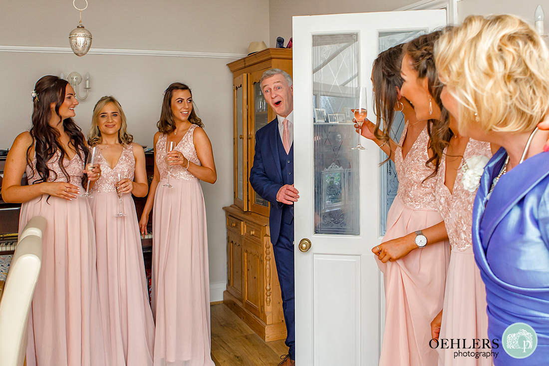 Osmaston Park wedding photography - Dad walking through the door to see his daughter in her dress.