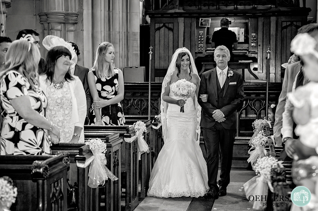 Osmaston Park wedding photography - Black and White Photograph of the bride and her dad walking down the aisle.