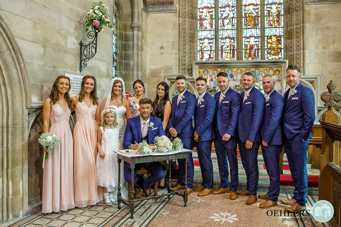 Osmaston Park wedding photography - bridal party lined up behing the registration table