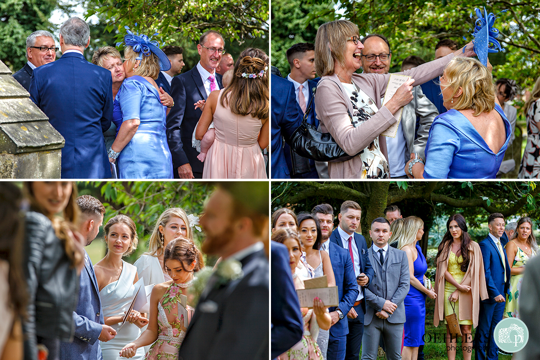 Osmaston Park wedding photography - guests lining up for the confetti outside the church.