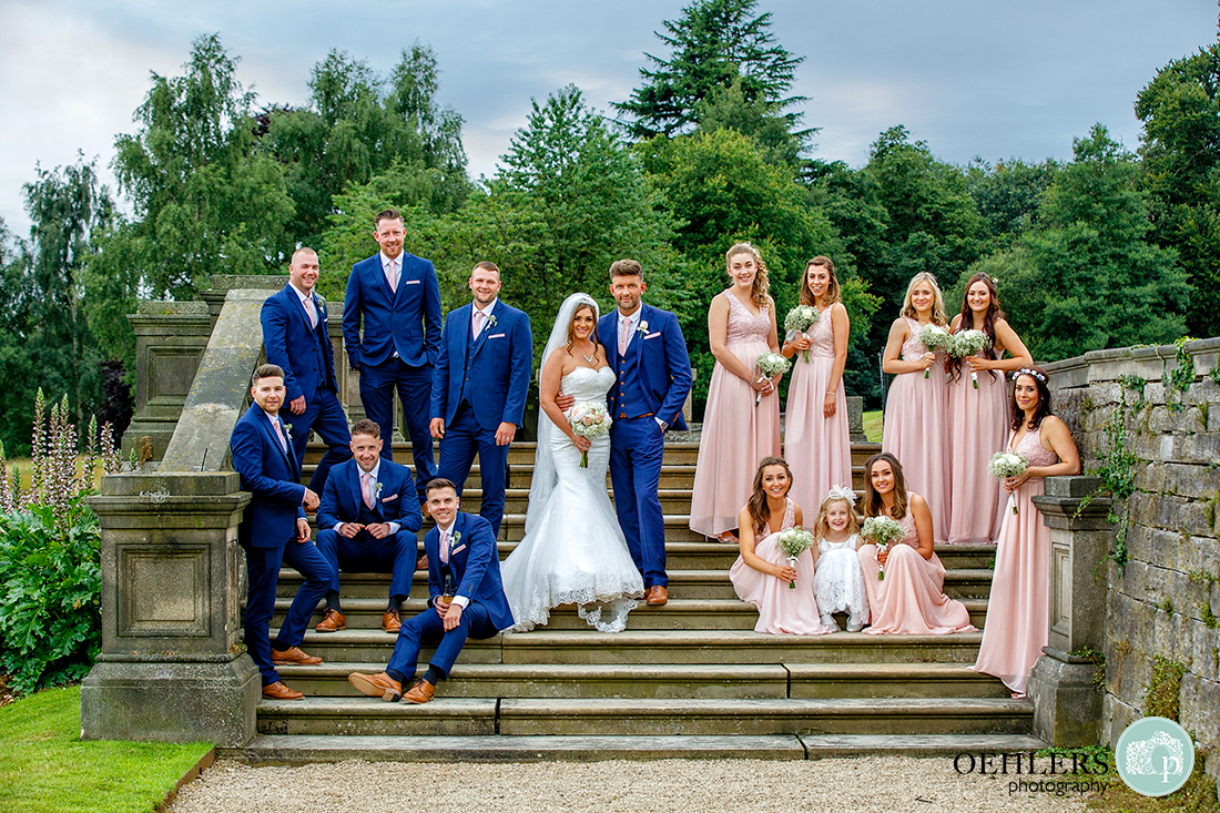 a casual group shot of the bridesmaids and groomsmen