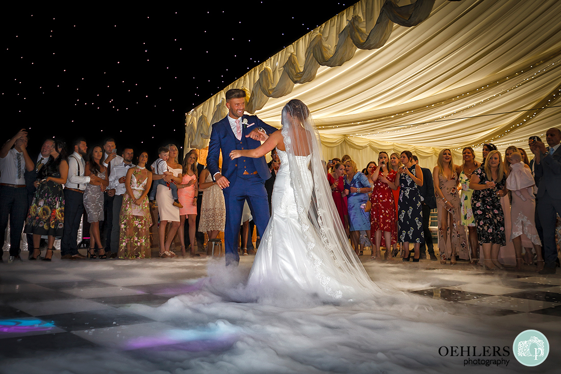 Osmaston Park wedding photography - first dance with dance floor covered in smoke